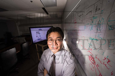 10401 Professor Xinhui Zhang, Edelman Award Finalist,  in his lab 1-7-13