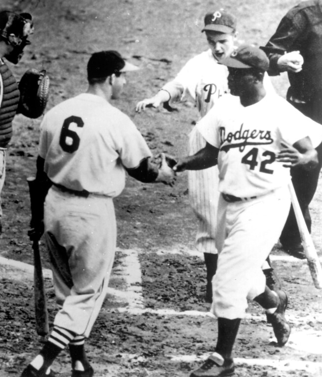 . Jackie Robinson is congratulated by Stan Musial.  (Los Angeles Daily News file photo)