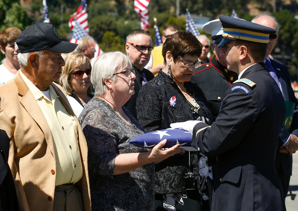 . Marlene Baisa, middle, the niece of Sgt. 1st Class Joseph Steinberg is presented an American flag by a member of the honor guard at Golden Gate National Cemetery in San Bruno, Calif., on Aug. 1, 2013.  (John Green/Bay Area News Group)