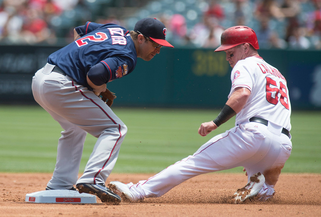 . The Minnesota Twins second baseman Brian Dozier (#2) receives the ball late as Angels\' Kole Calhoun steals second base during their game at Angel Stadium in Anaheim on Thursday June 26, 2014. (Photo by Keith Durflinger/Whittier Daily News)