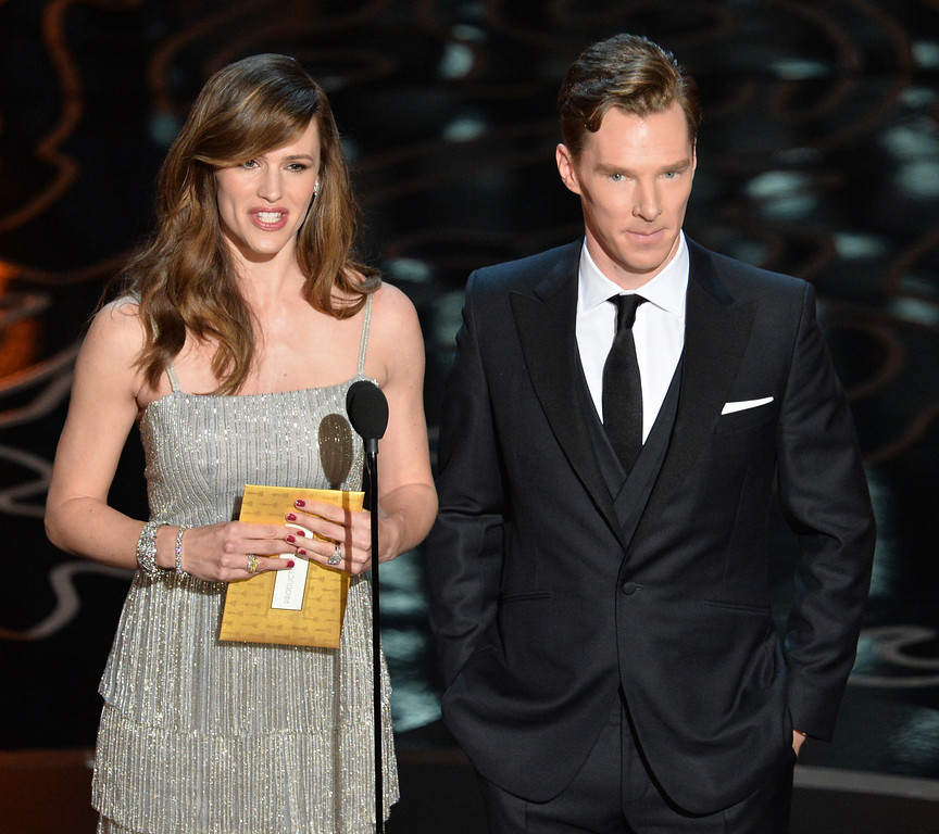 . Actors Jennifer Garner and Benedict Cumberbatch speak onstage during the Oscars at the Dolby Theatre on March 2, 2014 in Hollywood, California.  (Photo by Kevin Winter/Getty Images)