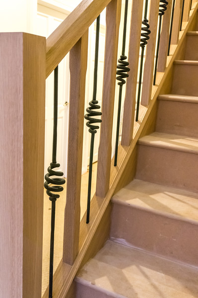 Alternating Oak and custom made iron detail spindles.