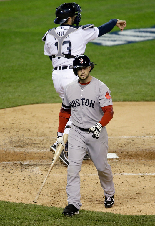 . Boston Red Sox\'s Daniel Nava walks off after striking out in the fourth inning during Game 4 of the American League baseball championship series against the Detroit Tigers, Wednesday, Oct. 16, 2013, in Detroit. Behind Nava is Tigers catcher Alex Avila. (AP Photo/Carlos Osorio)