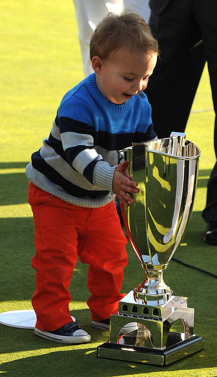 . Caleb Watson runs out to see the trophy won by his father Bubba Watson at the 2014 Northern Trust Open. Pacific Palisades, CA. February 13, 2014 (Photo by John McCoy / Los Angeles Daily News)