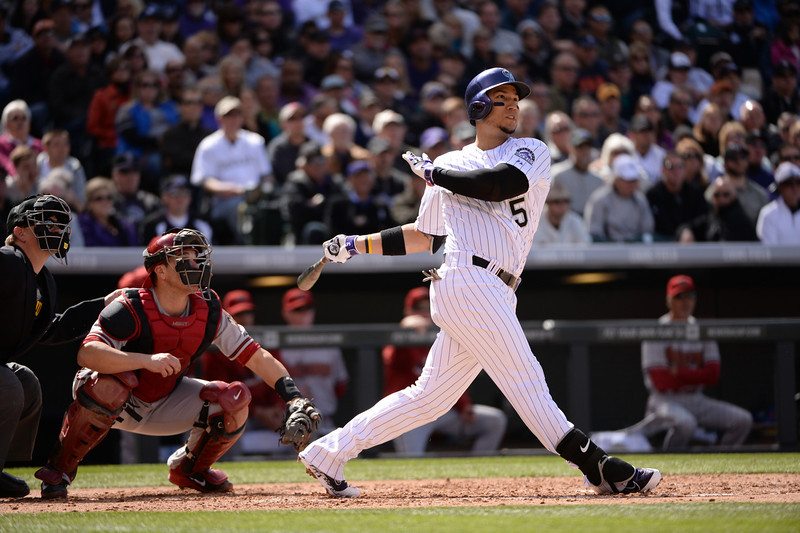 . Carlos Gonzalez hits a triple for 2 RBIs during the third inning. The Colorado Rockies hosted the Arizona Diamondbacks in the Rockies season home opener at Coors Field in Denver, Colorado Friday, April 4, 2014. (Photo by Hyoung Chang/The Denver Post)