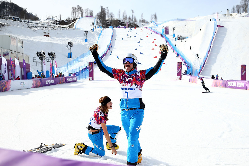 . SOCHI, RUSSIA - FEBRUARY 22:  Men\'s bronze medalist Benjamin Karl of Austria celebrates with gold medallist Julia Dujmovits of Austria in the Snowboard Parallel Slalom on day 15 of the 2014 Winter Olympics at Rosa Khutor Extreme Park on February 22, 2014 in Sochi, Russia.  (Photo by Cameron Spencer/Getty Images)