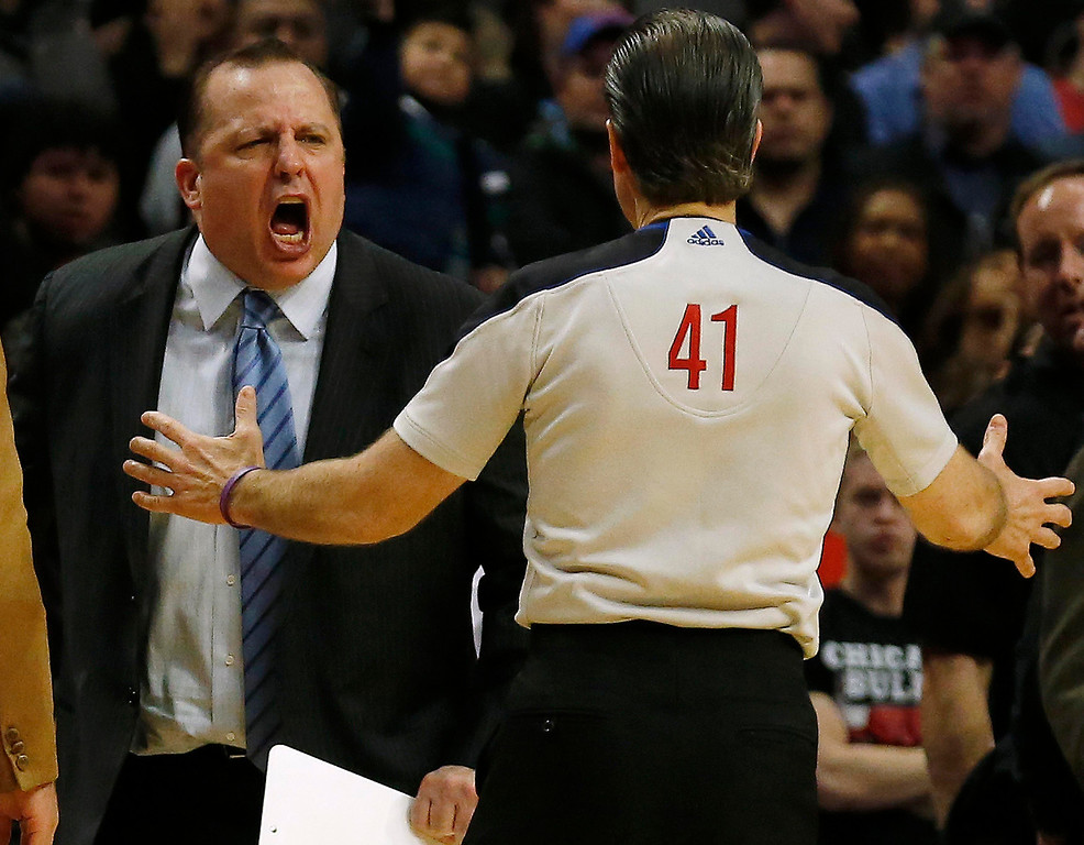 . Chicago Bulls coach Tom Thibodeau (L) argues with referee Ken Mauer during the overtime of their NBA basketball game against the Denver Nuggets in Chicago, Illinois March 18, 2013. REUTERS/Jim Young