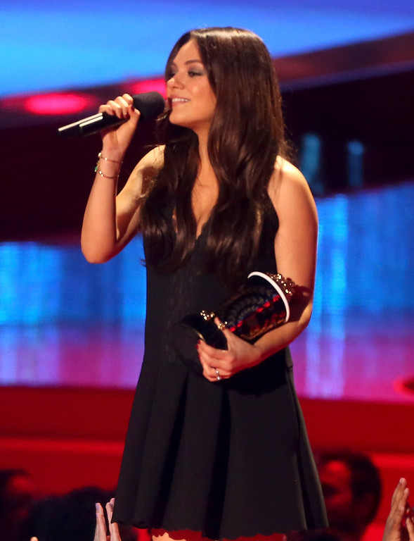 . Actress Mila Kunis speaks onstage at the 2014 MTV Movie Awards at Nokia Theatre L.A. Live on April 13, 2014 in Los Angeles, California.  (Photo by Frederick M. Brown/Getty Images)