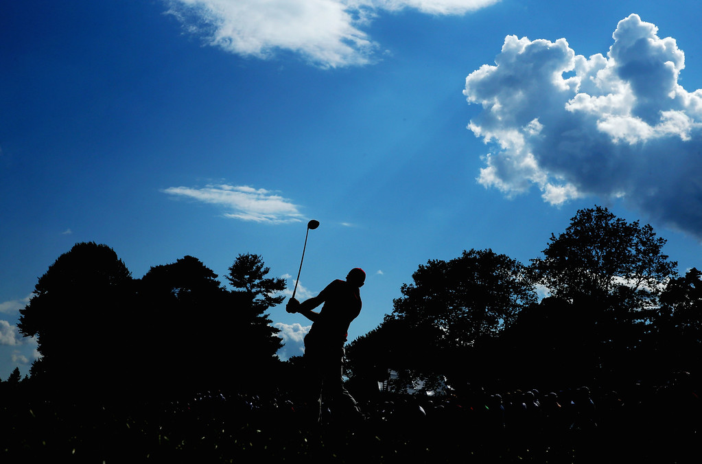 . Dustin Johnson of the United States hits his tee shot on the sixth hole during Round Two of the 113th U.S. Open at Merion Golf Club on June 14, 2013 in Ardmore, Pennsylvania.  (Photo by Andrew Redington/Getty Images)
