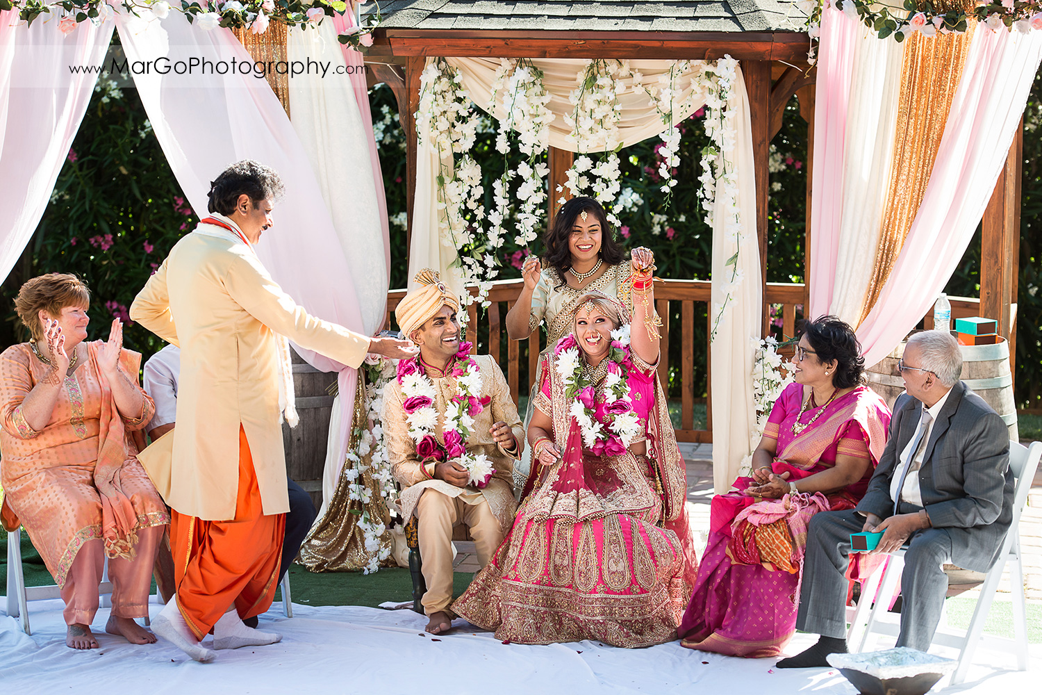 bride and groom under mandap during Indian wedding ceremony at Elliston Vineyards in Sunol