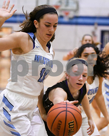 Downers Grove North and Downers grove South girls basketball