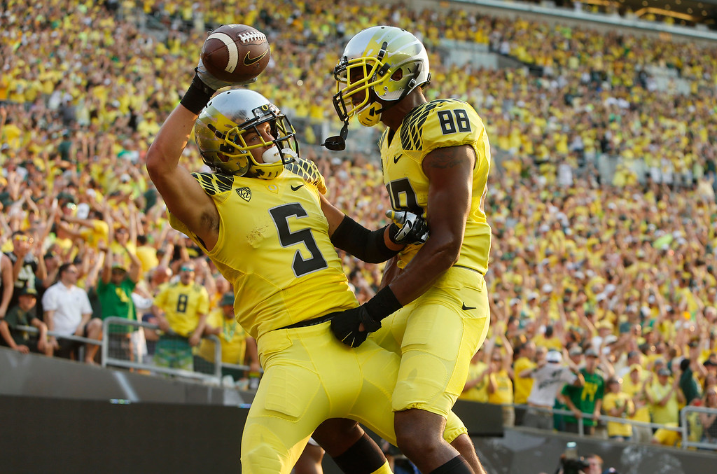 . Oregon\'s Devon Allen, left, celebrates with teammate Dwayne Stanford after scoring in the 3rd quarter against Michigan State in their NCAA college football game in Eugene, Oregon, Saturday Sept. 6, 2014. (AP Photo/Chris Pietsch)