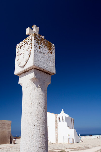 Stone cross with the Portuguese national emblem, fortress of the town of Sagres, municipality of Vila do Bispo, district of Faro, region of Algarve, southwestern Portugal
