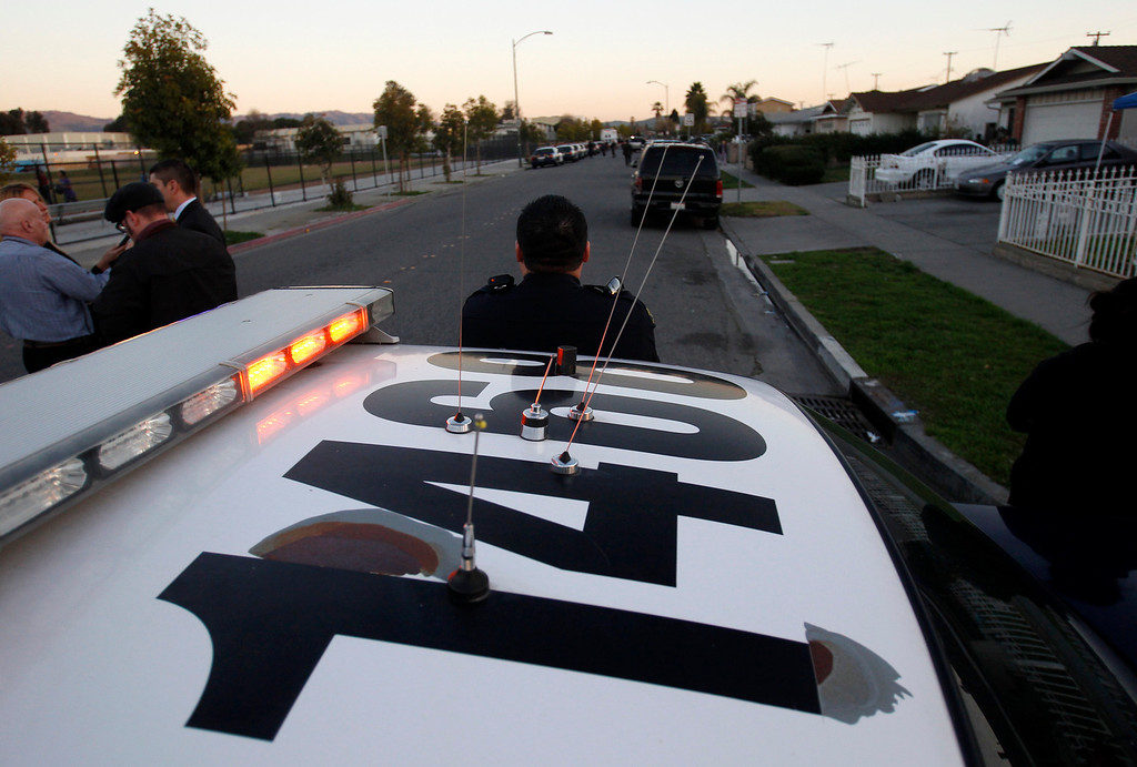 . San Jose Police Officers investigate a double homicide at a home on the 1800 block of Bermuda Way in San Jose, Calif., on Thursday, Feb. 14, 2013.  (Nhat V. Meyer/Staff)