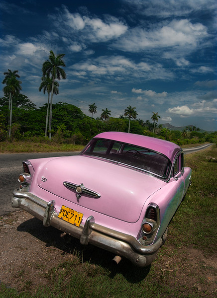 Once Castro took over the control of the island in 1959 it became impossible for most Cubans to obtain permission to buy cars. Therefore, like white Rhinos in fear of extinction, people take great care to preserve the the vintage gems that dot the Cuban highways.   Playas del Este, Cuba, 2006.