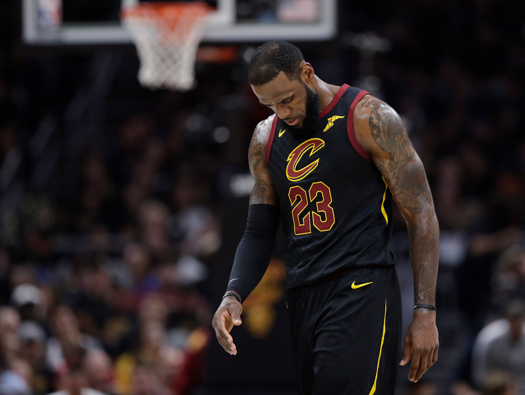 . Cleveland Cavaliers\' LeBron James walks to the bench during the first half of Game 4 of basketball\'s NBA Finals against the Golden State Warriors, Friday, June 8, 2018, in Cleveland. (AP Photo/Tony Dejak)