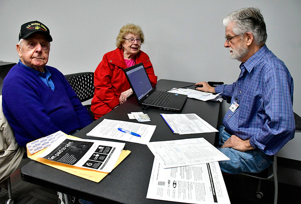 2/19/2019 Mike Orazzi | Staff Joe and Germaine Caminiti get help with their tax returns from David Radl during a program by the United Way of West Central Connecticut, in partnership with HRA of New Britain, for a free tax preparation site for individuals residing in Bristol, Burlington, Plainville, Plymouth and Terryville throughout the tax season in Bristol Tuesday.