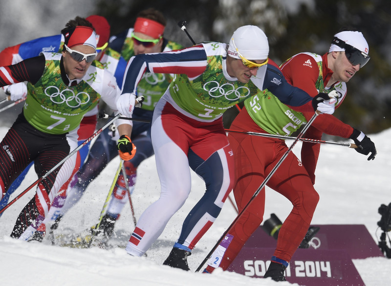 . Austria\'s Max Hauke (7-2), Norway\'s Petter Jr Northug (1-2) and Switzerland\'s Gianluca Cologna (5-2) compete in the Men\'s Cross-Country Skiing Team Sprint Classic Semifinals at the Laura Cross-Country Ski and Biathlon Center during the Sochi Winter Olympics on February 19, 2014 in Rosa Khutor near Sochi. (ODD ANDERSEN/AFP/Getty Images)