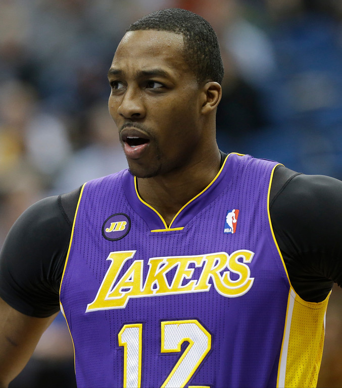 . Los Angeles Lakers\' Dwight Howard is shown in the first quarter of an NBA basketball game against the Minnesota Timberwolves Wednesday, March 27, 2013 in Minneapolis. (AP Photo/Jim Mone)