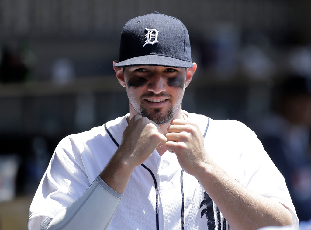 . Detroit Tigers third baseman Nick Castellanos shadow boxes in the dugout before the first inning of a baseball game against the Toronto Blue Jays in Detroit, Thursday, June 5, 2014. (AP Photo/Paul Sancya)