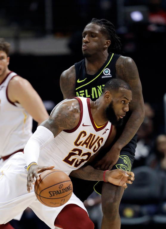 . Cleveland Cavaliers forward LeBron James (23) drives against Atlanta Hawks forward Taurean Prince (12) in the first half of an NBA basketball game Friday, Feb. 9, 2018, in Atlanta. (AP Photo/John Bazemore)