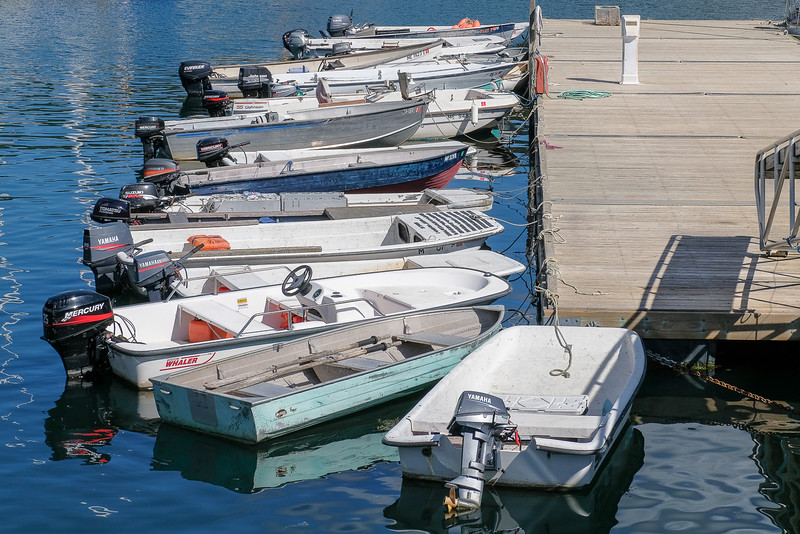 Small Boats Tied To Pier