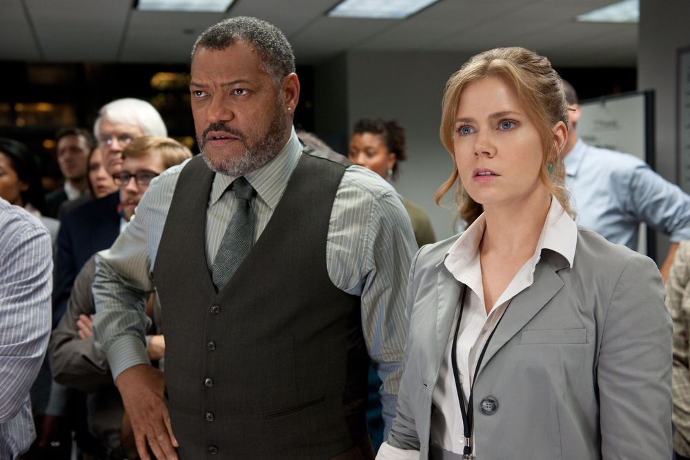 """. This film publicity image released by Warner Bros. Pictures shows Laurence Fishburne as Perry White, left, and Amy Adams as Lois Lane in \""""Man of Steel.\"""" (AP Photo/Warner Bros. Pictures, Clay Enos)"""