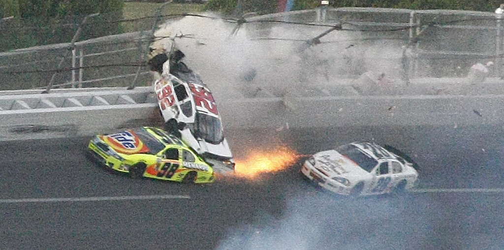 . Dennis Setzer (92) crashes into the Paul Menard (98) as Kenny Wallace passes by during the NASCAR Nationwide Series Aaron\'s 312 auto race at Talladega Superspeedway in Talladega, Ala., Sunday, April 25, 2010. (AP Photo/Ron Sanders)
