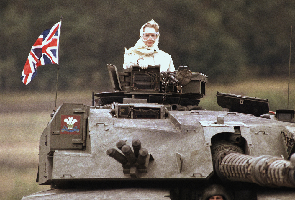 . British Prime Minister Margaret Thatcher stands in a British tank during a visit to British forces in Fallingbostel, some 120km (70 miles) south of Hamburg, Germany. on Sept. 17, 1986. Thatchers former spokesman, Tim Bell, said that the former British Prime Minister Margaret Thatcher had died Monday morning, April 8, 2013, of a stroke. She was 87.(AP Photo/Jockel Fink)