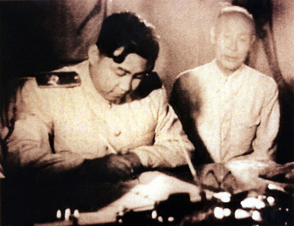 . This undated photo shows North Korean leader Kim Il-Sung (L) as he signs a document in Seoul, Korea. North Korean troops invaded South Korea 25 June 1950, marking the beginning of the Korean War.        (AFP/Getty Images)