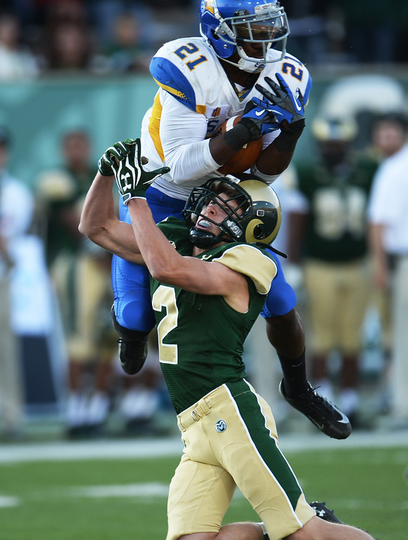 . FORT COLLINS, CO - OCTOBER 12 : Bene Benwikere of San Jose State (21), top, intercepts the ball over Thomas Coffman of Colorado State (2) at Hughes Stadium. Fort Collins. Colorado. October 12, 2013. San Jose won 34-27. (Photo by Hyoung Chang/The Denver Post)