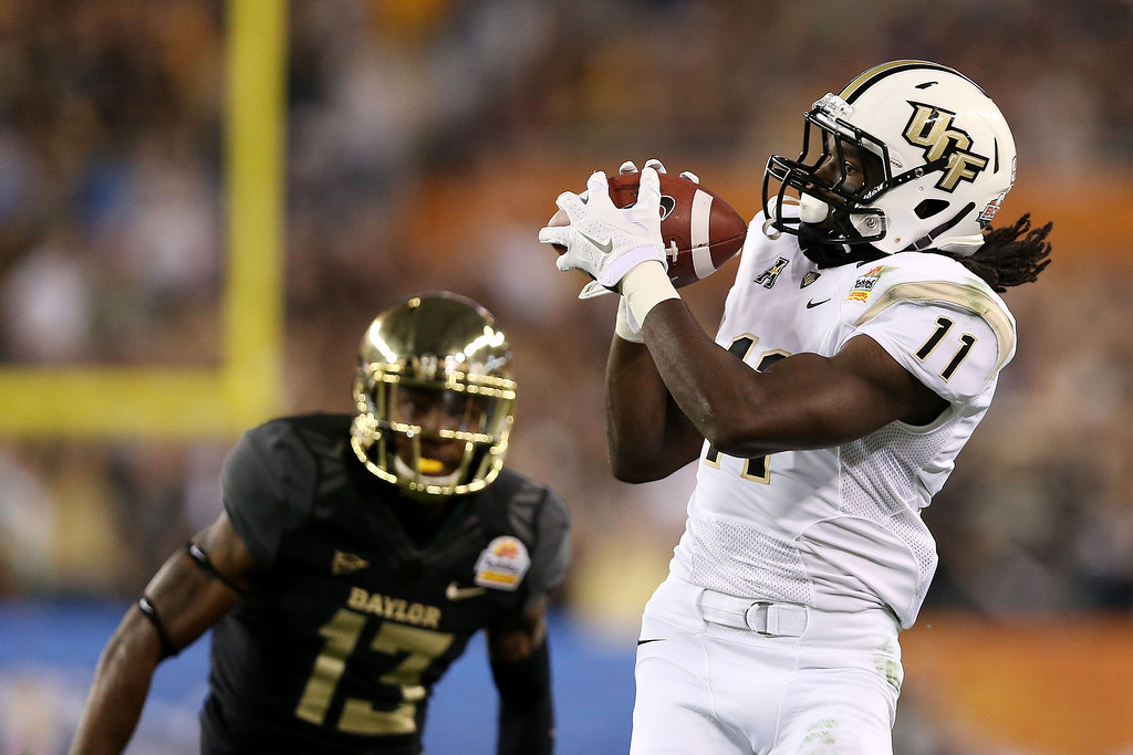 . Breshad Perriman #11 of the UCF Knights completes a pass for 44 yards in the first quarter against the defense of Terrell Burt #13 of the Baylor Bears during the Tostitos Fiesta Bowl at University of Phoenix Stadium on January 1, 2014 in Glendale, Arizona.  (Photo by Christian Petersen/Getty Images)