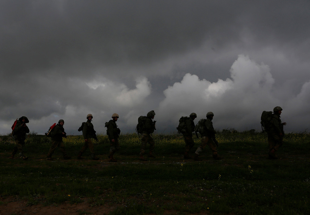 . Israeli soldiers from the Nahal infantry brigade take part in a drill in the Golan Heights, near Israel\'s border with Syria March 5, 2013. Israel captured the Golan Heights from Syria in the 1967 Middle East war and annexed the territory in 1981, a move not recognised internationally. REUTERS/Baz Ratner