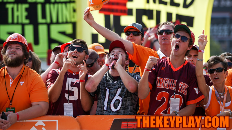 Virginia Tech and Tennessee fans cheer for the cameras during a commercial break. (Mark Umansky/TheKeyPlay.com)