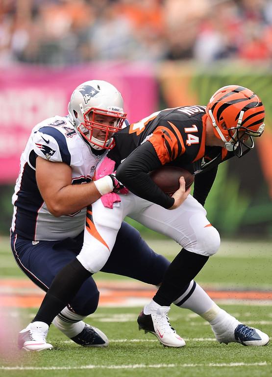 . Chris Jones #94 of the New England Patriots sacks quarterback Andy Dalton #14 of the Cincinnati Bengals in the second quarter at Paul Brown Stadium on October 6, 2013 in Cincinnati, Ohio.  (Photo by Jamie Sabau/Getty Images)