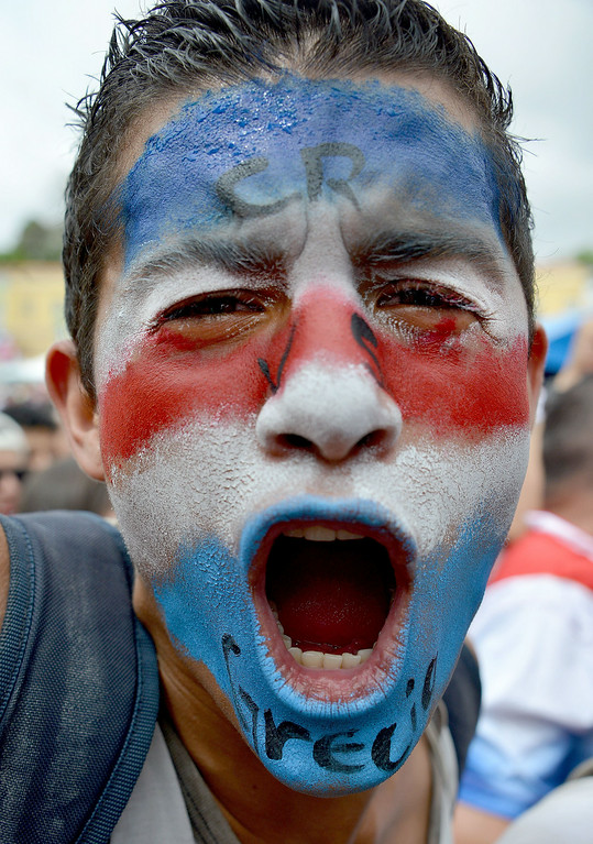 . Fans of Costa Rica react while attending the live broadcast of the FIFA World Cup Round of 16 match against Greece on June 29, 2014 in San Jose.    EZEQUIEL BECERRA/AFP/Getty Images