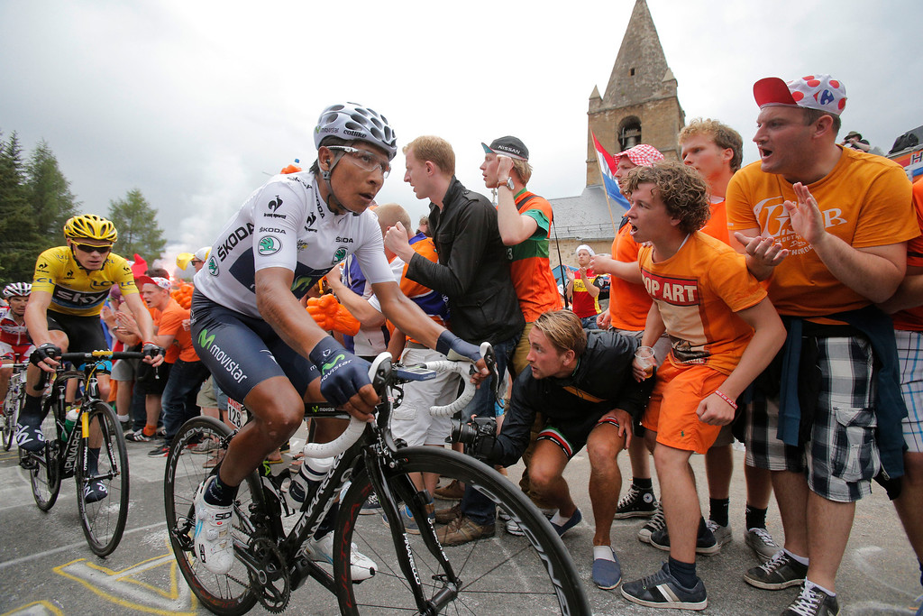 . Nairo Alexander Quintana of Colombia, wearing the best young rider\'s white jersey, and Christopher Froome of Britain, wearing the overall leader\'s yellow jersey, climb towards Alpe-d\'Huez pass during the eighteenth stage of the Tour de France cycling race over 172.5 kilometers (107.8 miles) with start in Gap and finish in Alpe-d\'Huez, France, Thursday July 18, 2013. (AP Photo/Christophe Ena)