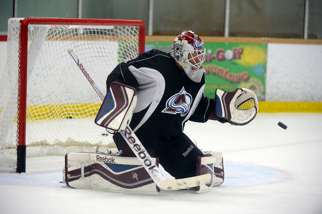 . Colorado Avalanche G J.S. Giguere (35) makes a save during practice September 10, 2013 at Family Sports.  (Photo By John Leyba/The Denver Post)