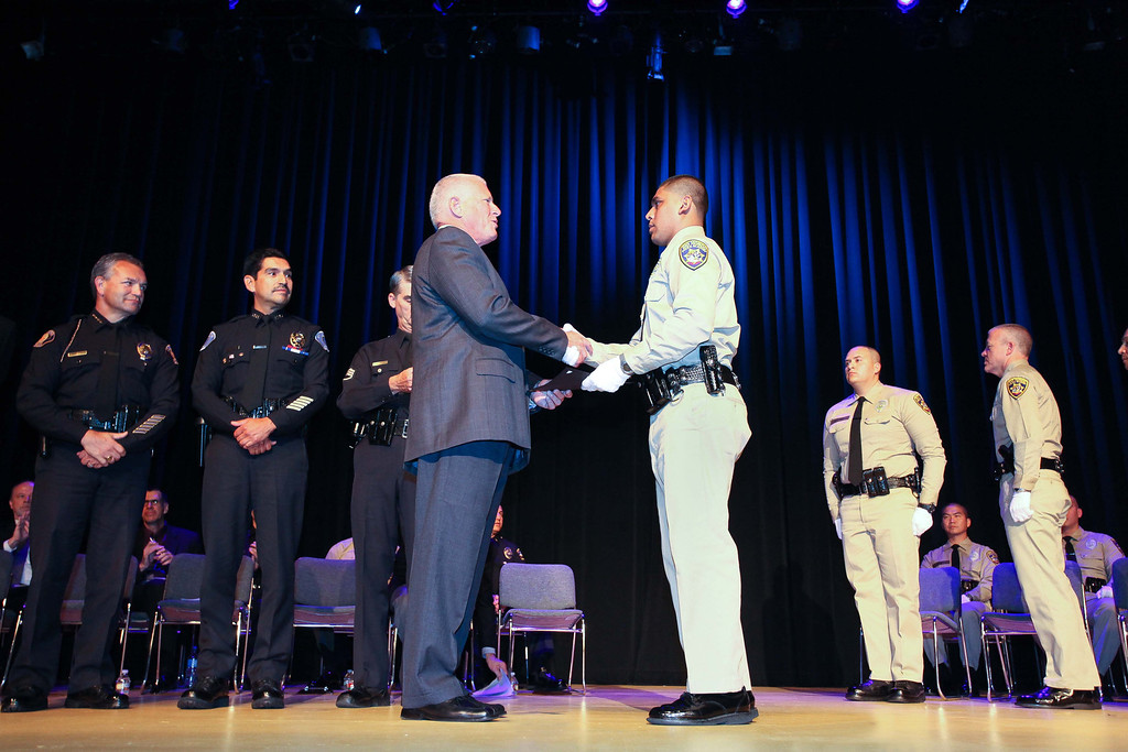 . Retired Gilroy Assistant Police Chief Lanny Brown congratulates Rio Hondo Police Academy graduate Felix Andrez. Rio Hondo celebrated their first Police Academy graduation since closing in 2010, Saturday morning July 13, 2013, at the Rio Hondo College Wray Theatre. (Correspondent photo by Chris Burt)