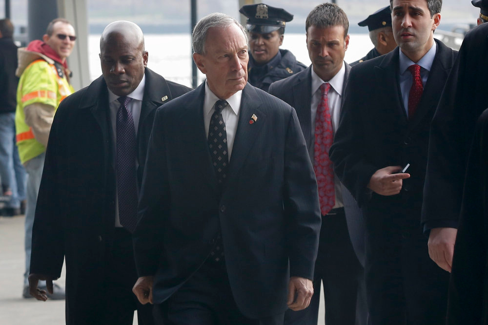 Description of . New York City Mayor Michael Bloomberg (C) walks the scene of a commuter ferry that crashed during the morning rush in New York, January 9, 2013. At least two of the people injured in a Wednesday morning commuter ferry accident in New York are in critical condition, and nine others are in serious condition, a city official said. The accident occurred at 8:43 a.m. (1343 GMT) as the high-speed catamaran was docking in lower Manhattan. More than 50 people were injured in the incident, New York City Department of Transportation Commissioner Janette Sadik-Khan said at a press briefing held near the scene.  REUTERS/Brendan McDermid