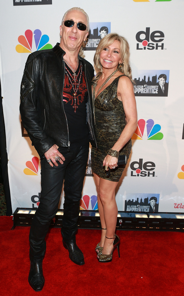 "Description of . Dee Snider (L) and Suzette Snider attend ""All Star Celebrity Apprentice\"" Finale at Cipriani 42nd Street on May 19, 2013 in New York City.  (Photo by Robin Marchant/Getty Images)"