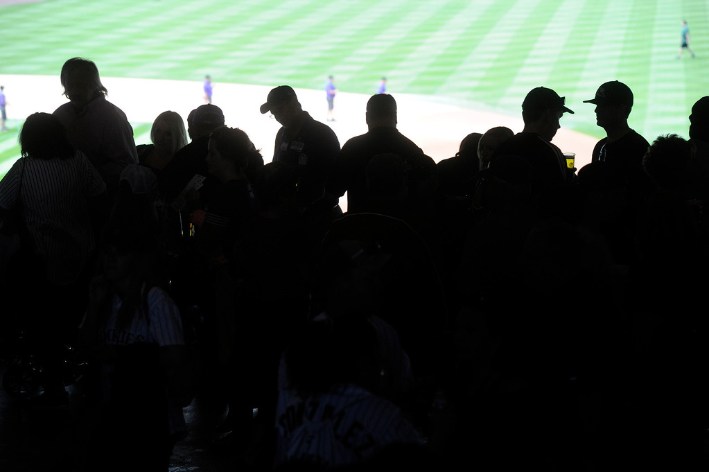 . Fans take their seats before the start of the game.  (Photo by Andy Cross/The Denver Post)
