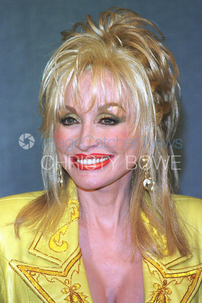 Singer / Actress Dolly Parton pauses prior to her speaking to a National Press Club audience about literacy.