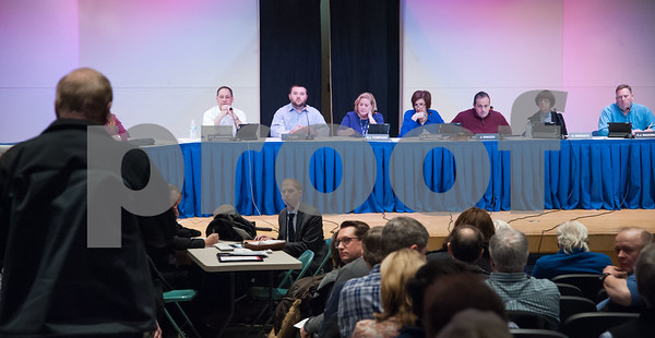 02/05/18 Wesley Bunnell   Staff A public hearing was held Monday evening at Plainville Middle School regarding the Farmington Canal Heritage Trail Gap Closure Trail Study. A audience member speaks as members of the committee are shown on stage in the background.