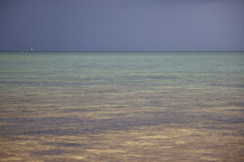 gray sky, clear water