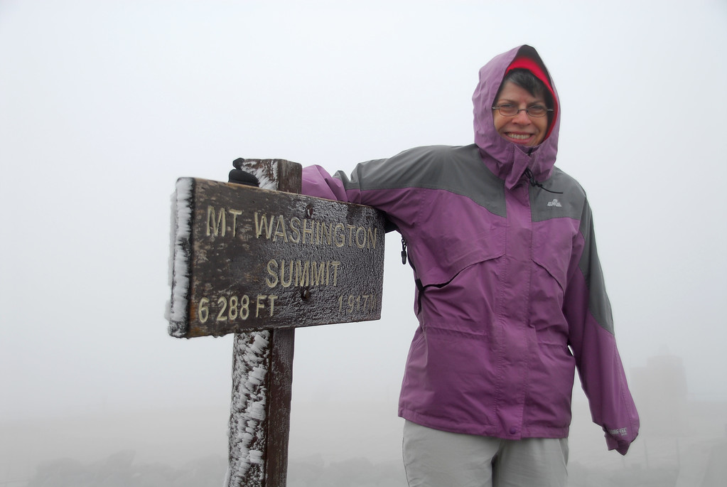 Jane at the summit of Mt. Washington. Temperature = 29 F. Hind speed = 65 mph. Visibility = 50 ft.