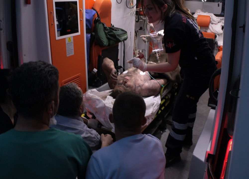 . Medics place an injured miner into an ambulance after an explosion and fire at a coal mine in Soma, in western Turkey, Tuesday, May 13, 2014. (AP Photo/Depo Photos)
