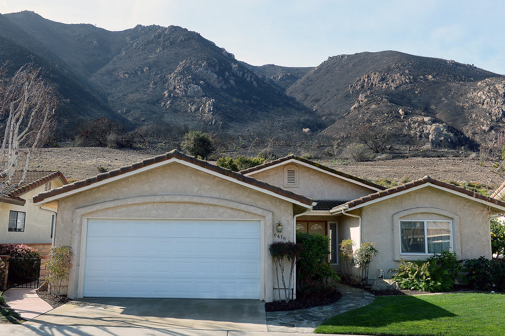 . A home in Camarillo Springs abuts against a burnt hillside from last year\'s Springs Fire, Thursday, February 27, 2014. (Photo by Michael Owen Baker/L.A. Daily News)