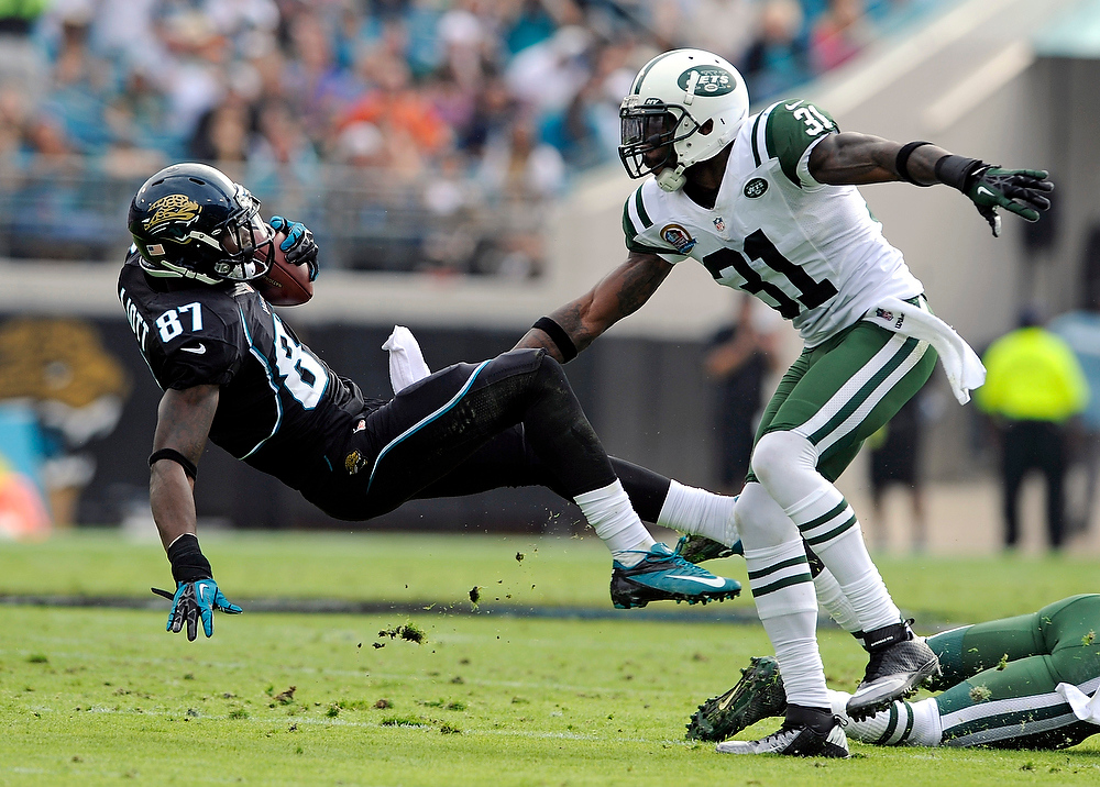 . Jacksonville Jaguars wide receiver Kevin Elliott (87) falls backward in front of New York Jets cornerback Antonio Cromartie (31) after a reception during the first half of an NFL football game, Sunday, Dec. 9, 2012, in Jacksonville, Fla. (AP Photo/Stephen Morton)