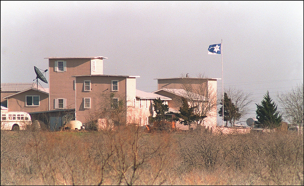 . A cult flag flies over the Branch Davidian compound in Waco, Texas on March 8, 1993. After a shootout in Waco in 1993 that killed four federal agents and six members of the Branch Davidian religious sect, authorities negotiated with cult leader David Koresh for 51 days. On the final day, April 19, 1993, a few hours after a government tank rammed the cult\'s wooden fortress, the siege ended in a fiery blaze, killing Koresh and 80 of his followers. Authorities later learned that leader David Koresh had renamed the compound Ranch Apocalypse and prophesied that the end of days from the Bible\'s Book of Revelations would begin there.     BOB STRONG/AFP/Getty Images